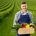 man holding basket with vegetables