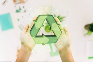 close up of person s hand with recycle icon
