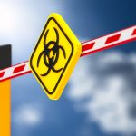 closed automatic barrier with symbol biohazard on white