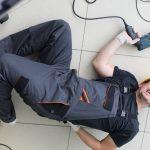 severe pain in back builder man lies on floor