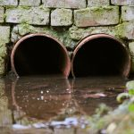 sewers with toxic dirty water from metal pipes