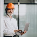 middle aged business man in hard hat