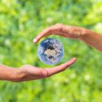 hands around earth miniature 1